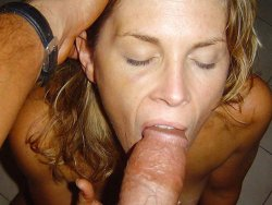 Tanned MILF wife gives oral sex to a very big cock