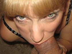 MILF wife looks mean while giving blowjobs