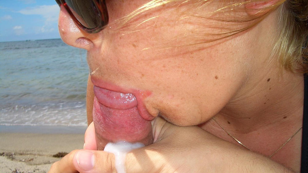 Horny amateur wife gets a mouthful on the nudist beach