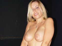 Swinging wife with big boobs giving blowjobs