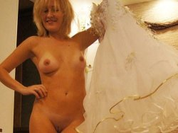 MILF bride stripping off her wedding dress