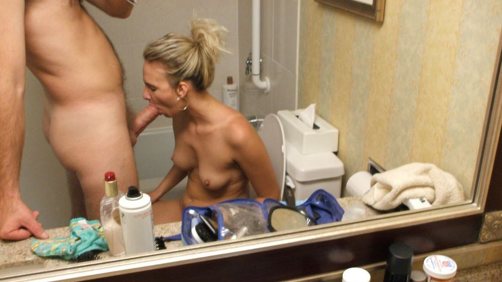 Mirror shot of this blonde wife giving a great blowjob