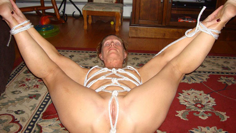 Mature wife in a tight rope bondage