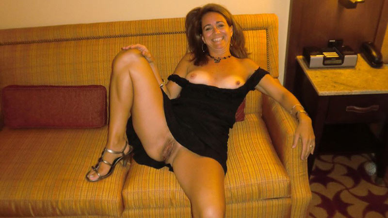 Aged housewife in a black dress forgot to wear panties