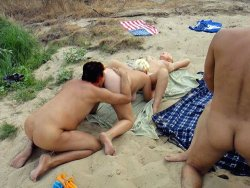 Swinger sex party on the public beach