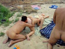 Swinger sex party on the public beach