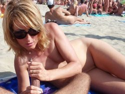 Mature wife gives a blowjob and a handjob on the public beach