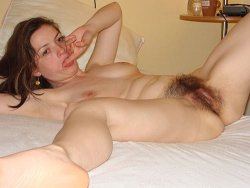 Small-tit MILF fingers her hairy jungle pussy