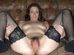 MILF slut in black stockings and a hairy pussy