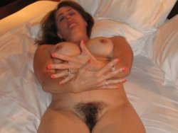 Busty amateur mom with a full hairy bush