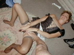 Mature wife in a French maid uniform fucking a dildo