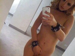 MILF slave takes selfies with her hand-cuffs
