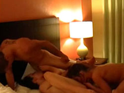 Hotel-room threesome with two hot wives and a lucky guy