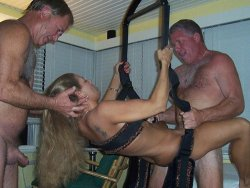 Horny mature wife in a sex swing gets gangbanged by everybody at this orgy