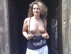 Real MILF flashing tits in public
