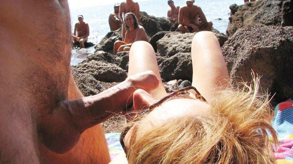 Mature nudist wife gives blowjobs on the beach