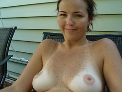 MILF naked and giving blowjobs at home
