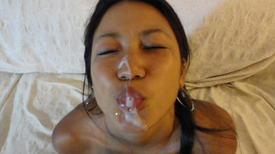Cute Asian MILF looks sexy after a big facial cumshot
