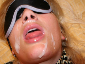 A homemade video of a real mature wife getting blindfolded and sprayed all over the face with hot cum.