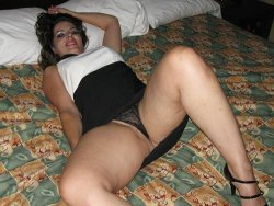 WifeBucket Pics | Chubby MILF in a sexy tight dress spreads on the bed