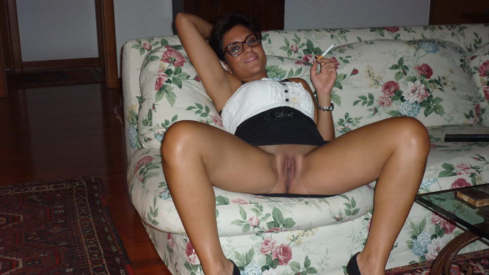 Kinky amateur wife spreading on the sofa