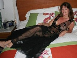 Mature housewife in a sexy gown