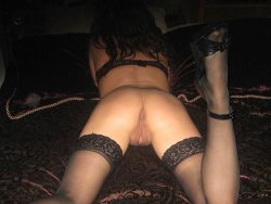 Slutty wife in stockings and high heels