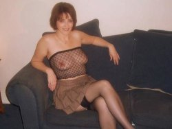 Mature wife in a see-thru top and a mini skirt