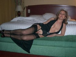 Mature blonde wife in a black gown
