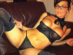 WifeBucket Pics | Trophey wife in sexy shiny lingerie on the couch