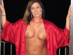 WifeBucket Pics | Busty mature wife in a sexy silk gown