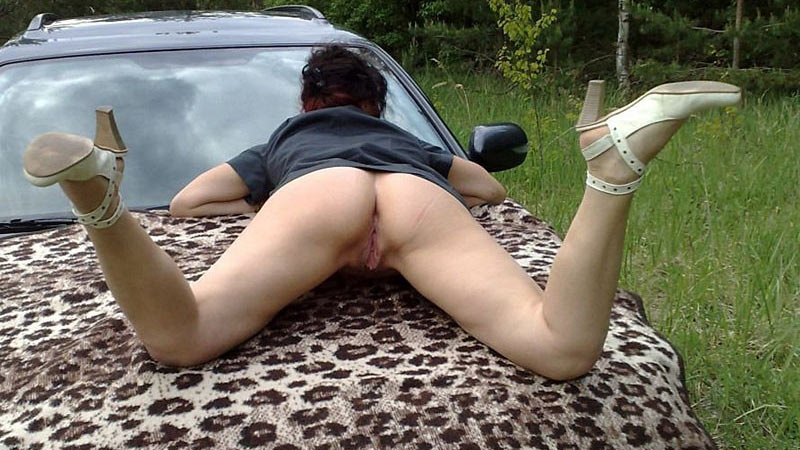 Mature wife spreading on the hood of the car waiting for cock