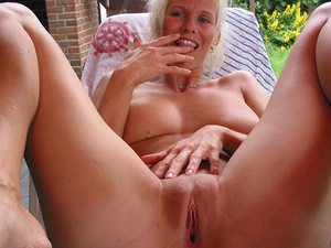 Older amateur cutie spends all day naked in the garden, gets horny under the hot sun, and fingers her pussy a lot.