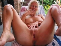 Older housewife fingering her pussy outdoor