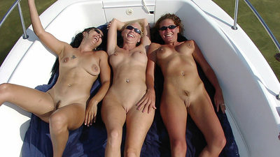 Mature GFs tanning naked on a yacht