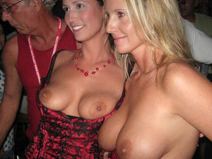 It's always fun in night clubs - people get excited, people party a lot - and these MILFs decided it would be great to strip butt-naked on the dance floor.