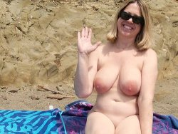 Busty mature wife on the nudist beach
