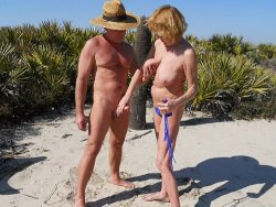 Mature swingers fuck on the nudist beach