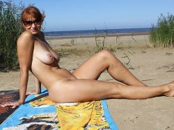 Fat wife with big tits is naked on the beach