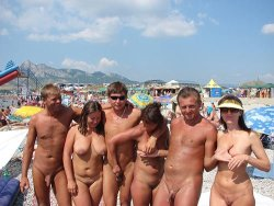 Swinger couples fucking on the nudist beach