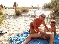 Mature wives fucking each other on the beach