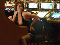 MILF slut flashes people at the casino