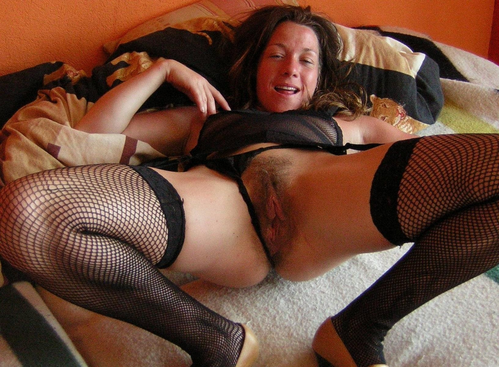 Hairy mature wife spreading wide in bed