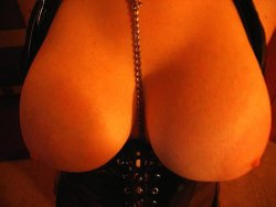 Big natural tits squeezed in a tight leather corset