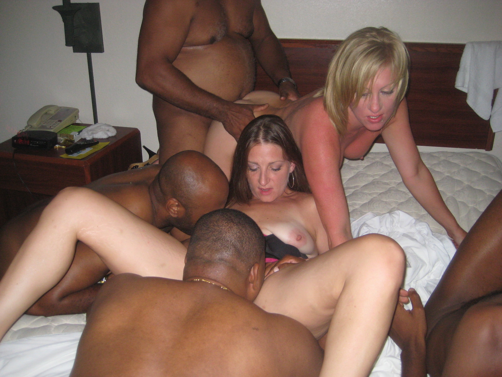 Real wives at an interracial orgy