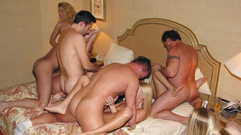 WifeBucket Pics | Swinger sex orgy in a hotel room