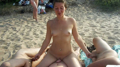 Swinger couples having an orgy on the nudist beach