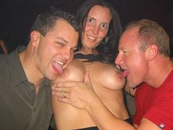 This big-tit MILF is the attraction in the swing club