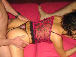 Cute and horny brunetter wife getting split-roasted by her hubby and a friend at home.