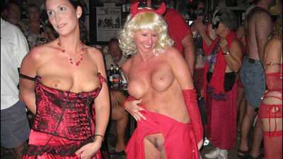 Mature wives in sexy costumes and lingerie in the swingers sex club